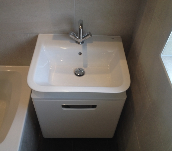 Roca wall hung basin and cabinet - basin mixer tap - clicker waste.