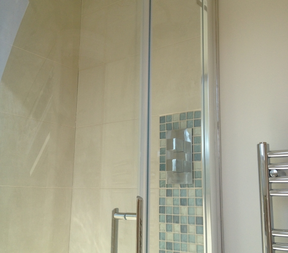 Concealed shower valve - mosaic tiles.
