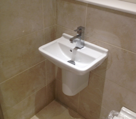 Cloakroom basin and semi pedestal.