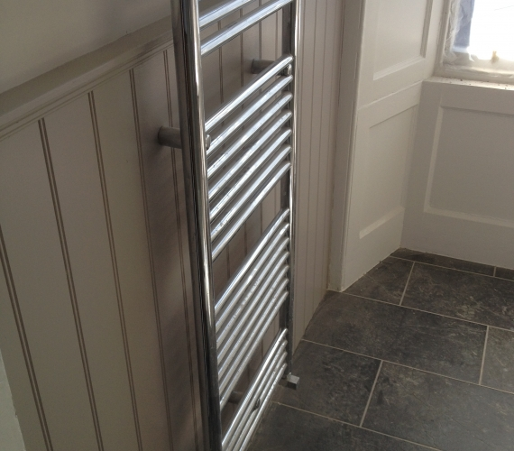 Chrome towel radiator.