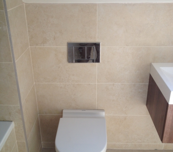 BTW W/C with Geberit concealed cistern and flush plate.