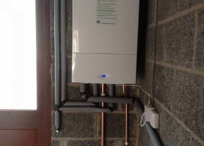 Worcester Bosch combination boiler installation in garage - wireless programmable room thermostat.