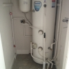 Unvented (pressurised) hot water cylinder.